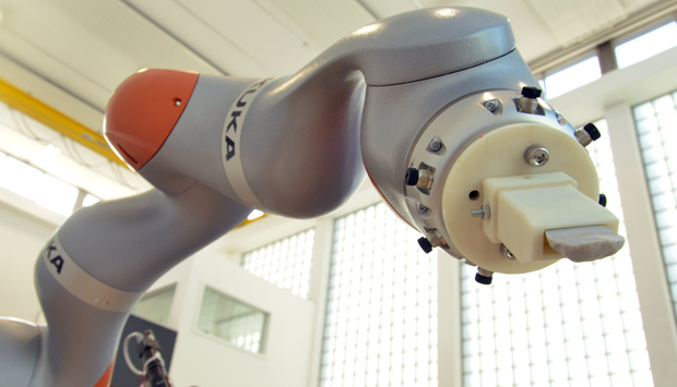Robot Arm Brings Humanity Back to the Stone Age